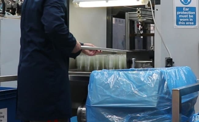 Thermoforming machine & the packing area for all the food packaging that is created.